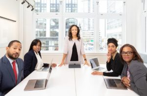 woman-standing-on-the-center-table-with-four-people-on-the