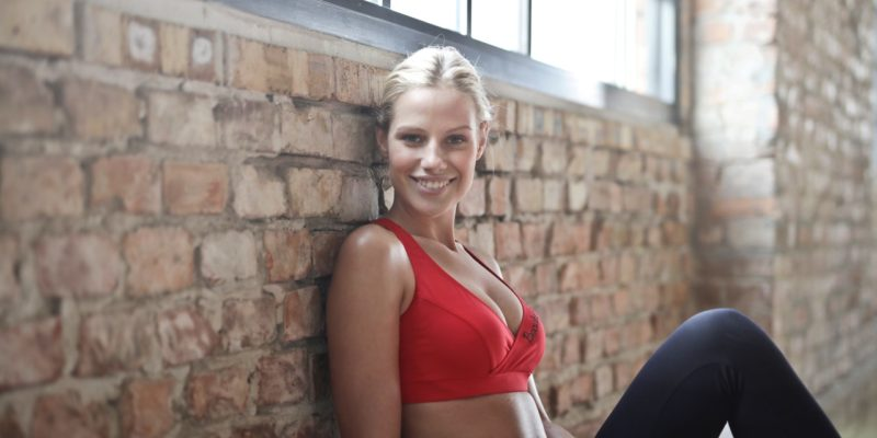 woman-wearing-red-sports-bra-and-black-pants